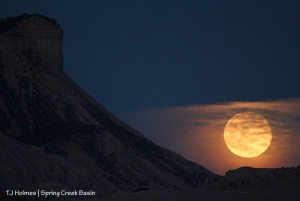The full moon rises beyond Temple Butte, Spring Creek Basin.
