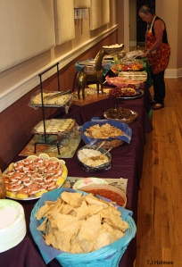 Kathe Hayes arranges food at the NMA/CO fundraiser at the Sunflower Theatre in Cortez.