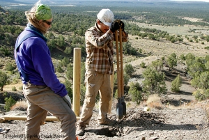 Southwest Conservation Corps members Eric and Aaron dig a hole while building an H-brace on the steep hill on Spring Creek Basin's southeastern boundary.