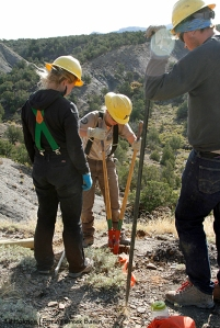 Southwest Conservation Corps members Toby, Sarah and Abby take turns digging a hole for an H-brace post on the steep hill on Spring Creek Basin's southeastern boundary.