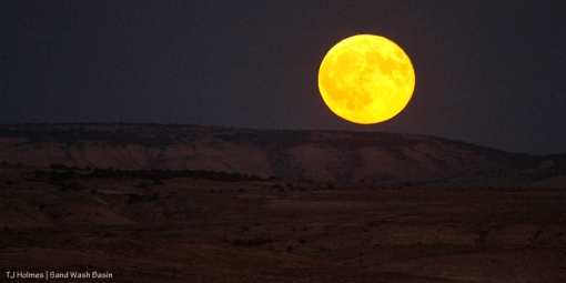 The full harvest moon rises over Sand Wash Basin.