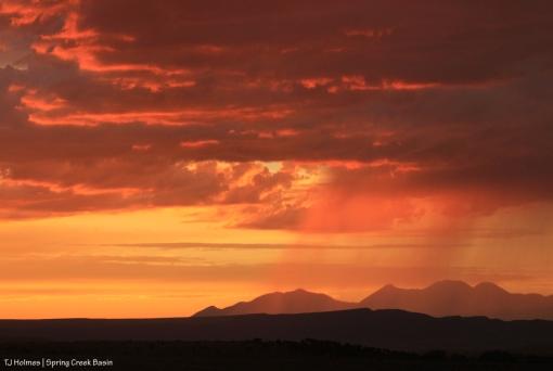 Rain over the La Sal Mountains at sunset.