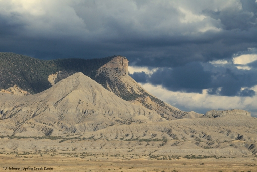 McKenna Peak and Temple Butte under stormy sky.